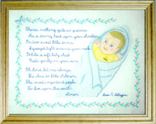 Interchangeable baby and prayer surrounded by baby rosebuds by Susan Saltzgiver Designs